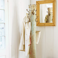 a coat rack made from a salvaged antique column