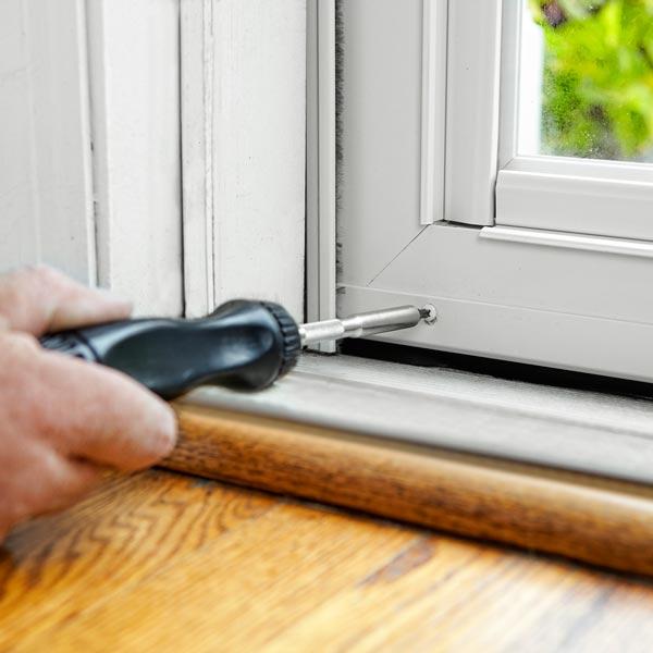 adjust the door sweep to install a storm door