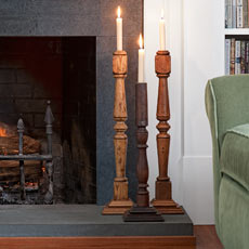 candlesticks made from balustrades in living room on fireplace hearth