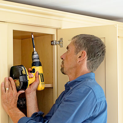 Attach it to the cabinets how to install kitchen for Attaching crown molding to kitchen cabinets