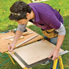 Using a framing square, draw two perpendicular lines on the plywood