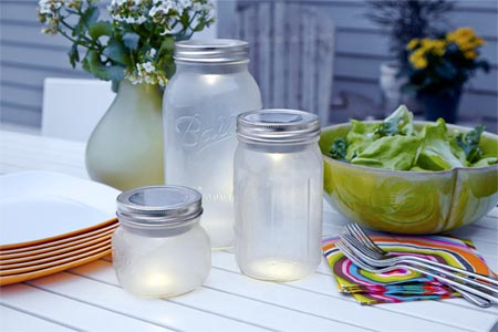 Make Solar Lanterns From Mason Jars on an outdoor table