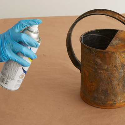 give a watering can a faux rust coating seal rusted surfaces with sealant