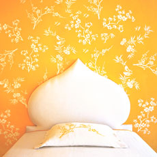 step by step stencil on wall surrounding headboard