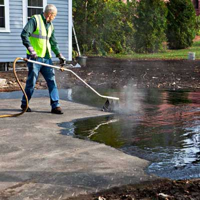 Apply the Bitumen to  Install a Low-Maintenance, All-Gravel Driveway