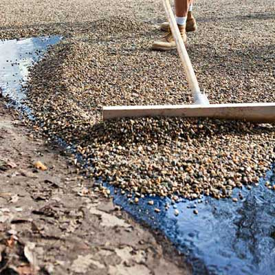 Spread the Stone to  Install a Low-Maintenance, All-Gravel Driveway
