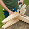 attaching the brackets and feet for a picnic bench