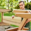 attaching the legs to the stretcher for a picnic bench