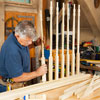 Tom Silva inserts balusters into the bottom rail