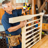 Tom Silva drives timber screws through the holes and into the ends of the rails