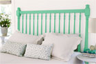 a finished spindle headboard behind a bed