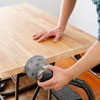 sanding the butcher-block with a random-orbit sander
