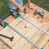 attaching floorboards to the stringers with a drill/driver
