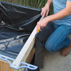 cutting the pond liner to fit with a straightedge and a utility knife