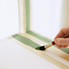 use artist's stencil brush to paint on stripes, painting stripes on chair