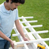 Mark Powers attaches the purlins with the help of a T-shaped block