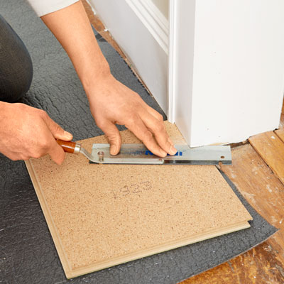 Mark Powers Uses A Flush Cut Saw To Trim The Door Casings
