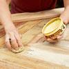 rubbing the paste wax onto the sliding barn door
