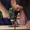 boy attaching the hinges to build an easel