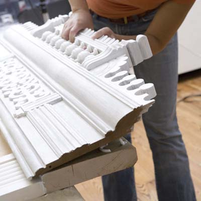 use the construction adhesive to affix the decorative entablature to the 2x4 top