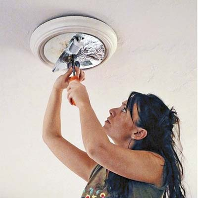 unscrew the nuts on the lighting fixture