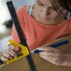 woman doing markings on shutters