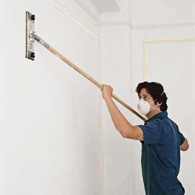 man clearing dust from teh walls