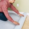 Unrolling foam underlay