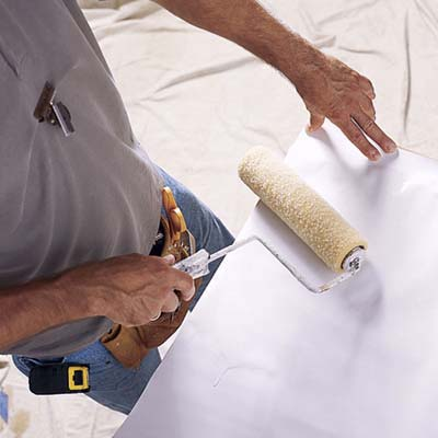 Rolling on wallpaper paste