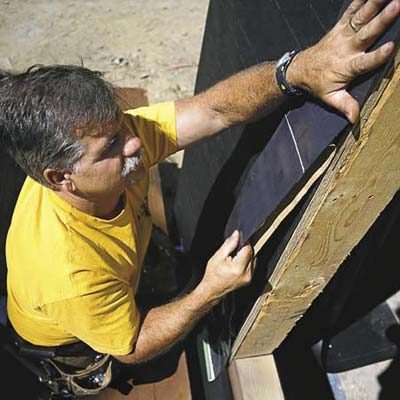 Tom Silva installing a window