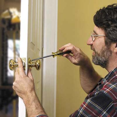 Norm Abram installing the latch assembly and knob of a lockset