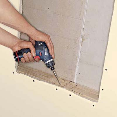 Installing the blocking using a drill.