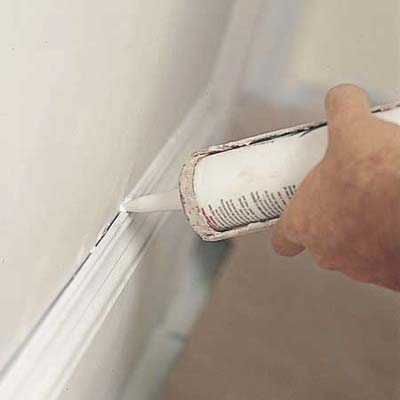 Caulking the gaps before painting a room