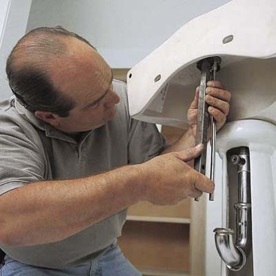 Mount the faucet How to Install a Pedestal Sink This Old House