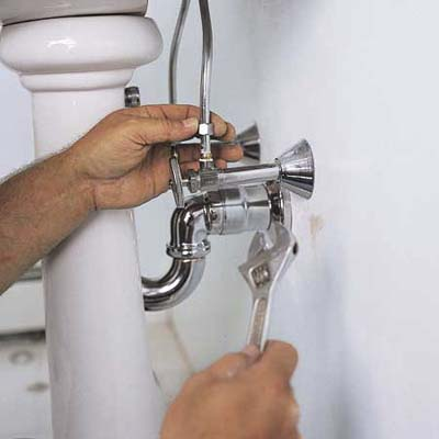 Connecting The Pipes Of A Pedestal Sink