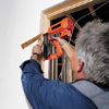 Tom Silva anchoring the jamb of a prehung door 