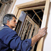 Tom Silva attaching the split jamb of a prehung door