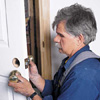 Tom Silva mounting the latch hardware of a prehung door