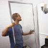 installing the remaining side jamb of a shower door