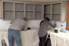 Kevin O'Connor helps a homeowner repaint an old kitchen