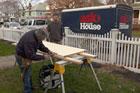 Tom Silva helps a homeowner hang an interior door