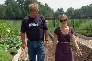 Roger Cook and Bedford homeowner touring vegetable gardens on episode 3107 of This Old House