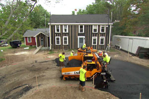 Working on the driveway of the Bedford house in episode 3108 of This Old House