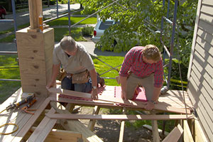 Tom Silva and Kevin O'Connor laying front porch mahogany flooring