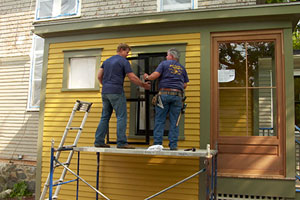 Kevin O'Connor and Tom Silva install a window replacement