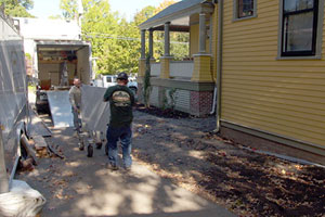 the crew delivers the new kitchen countertop to the Belmont Victorian