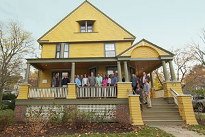the crew and everyone else involved in the Belmont Victorian house project on the front porch