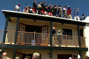 people gathered on the completed 2004 Bermuda house project