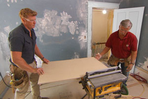Tom and Kevin install new wood wainscoting at the Charlestown 2014 house project