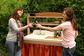 2 women toast in front of outdoor sink